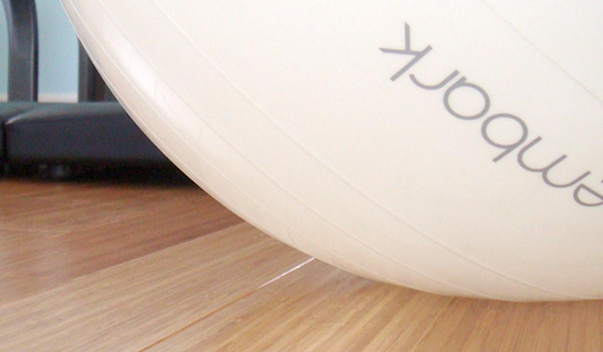 Close up of Pilates ball on the Pilates Boutique wood floor.