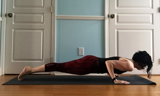 women in Pilates Push-Up position